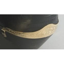 Protector del talón para bota grabado en cobre